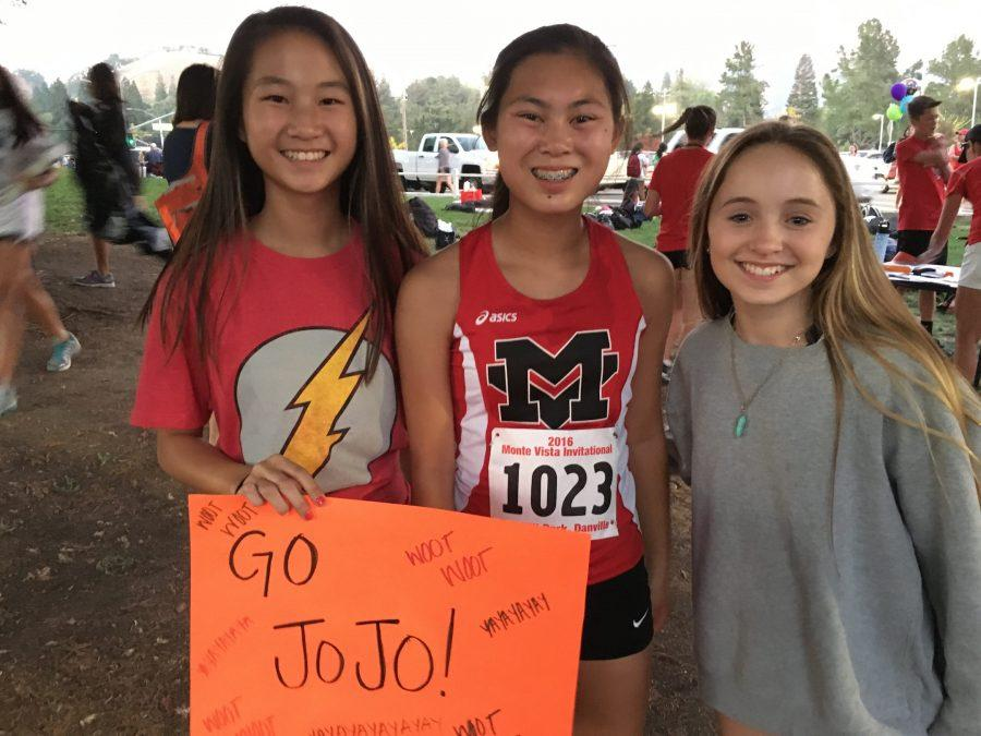 Josephine Lee at her Monte Vista Cross Country meet with her friends, Eliza and Christina, who are supporting her.