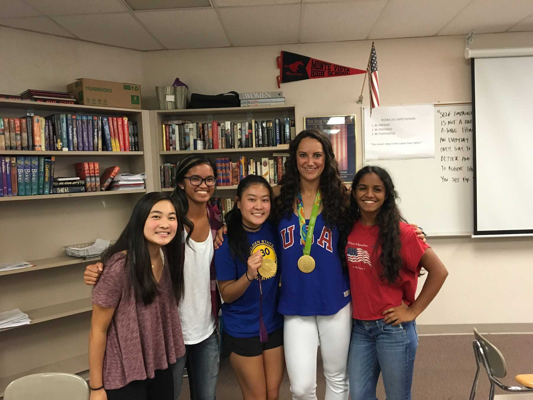 Maggie Steffens poses with Megan Okazaki, Katrina Flores, Taylor Okazaki, and Isha Satoor after school in Mr. Powers' room. (Courtesy of Megan Okazaki)