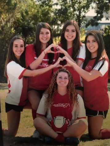 Left to right, Ashlyn Gonzales, Megan Brear , Alexis Liautaud, Alyssa Rutchena, and Nicole Varon, bottom all pose for a team soccer photo. They all played on the recreational level team, the Cosmos, up until high school, but decided to come back and play one last time for their senior year. (Courtesy of Megan Brear)