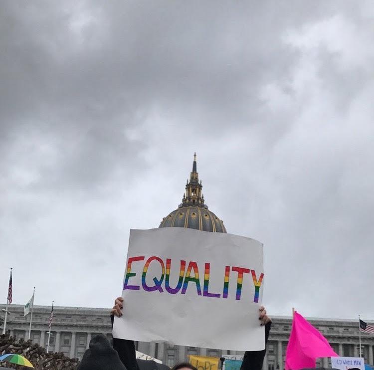 Civic+Center+Plaza%2C+San+Francisco-+Gay+Straight+Alliance+%28GSA%29+%0Amember+senior+Erin+Yoshina+raises+up+her+homemade+poster%2C%0Aheading+towards+Market+Street+for+the+SF+march.
