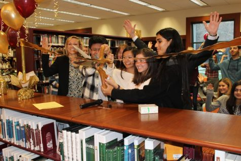 Teen Advisory Board members and Town Council members cut the ribbon officially opening the new Teen Zone at the Danville Library.