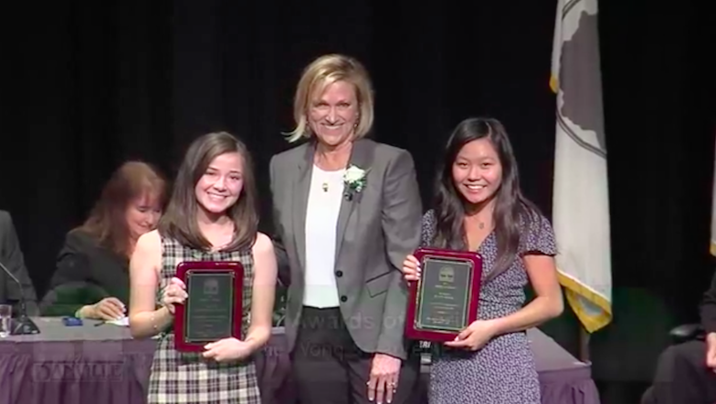 Monte Vista seniors Lauren Edelman and Katie Wong accept an Award of Merit for their extensive dedication in making Danville a better community. Brady Martin, also a Monte Vista senior, received an award the same night for his involvement in the Monte Vista community.