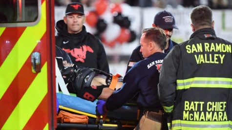 Monte Vista High football player Nate Rutchena (8) is loaded into an ambulance after being injured in the fourth quarter of their football game against San Ramon Valley High in Danville, Calif., on Friday, Oct. 26, 2018. San Ramon Valley High