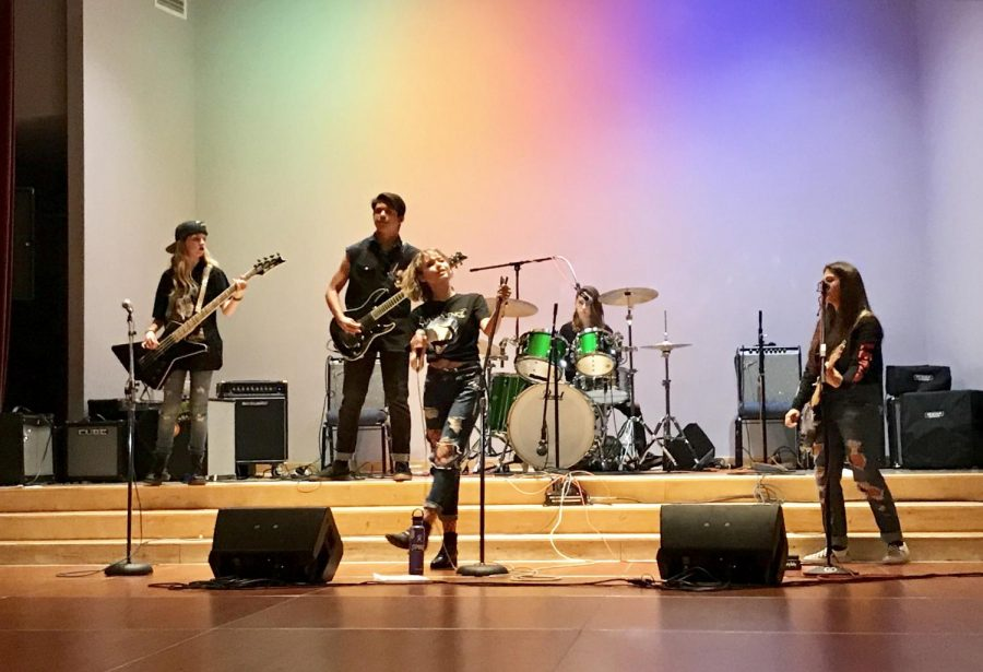 "The four members of the ""Step Back"" band performs at the San Ramon Teen Rock Band Showcase. Although they did not come out on top, they received one of the top votes."