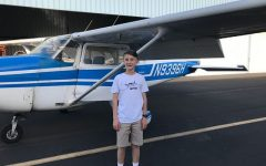 McCumiskey smiles before his first-ever flying lesson. He flew over Freemont with his flight instructor in a Cessna 172 Skyhawk.