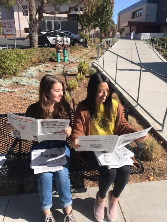 Editor-in-Chief Claire Chu and Managing Editor Raquel Montelindo read The Stampede's November edition. The two seniors have worked alongside one another for the past three years. In their graduating year, they look to provide the journalism program with a strong legacy for the future.
