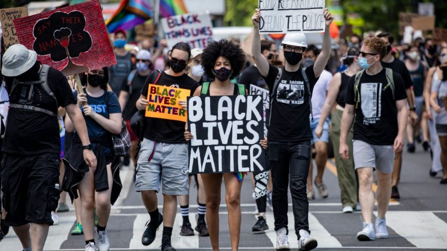 A+crowd+of+protesters+march+to+the+White+House+on+June+13%2C+2020+in+support+of+the+Black+Lives+Matter+movement.