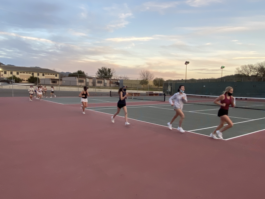 On+the+second+day+of+Monte+Vista+tryouts%2C+the+group+of+girls+are+jogging.+The+girls+had+already+completed+multiple+games+and+conditioning.+%0A