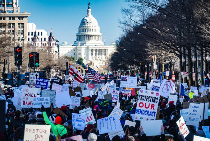 Biden+supporters+surround+the+U.S.+Capitol+on+Jan.+20+after+riots+broke+out+there+2+weeks+prior.+The+supporters+raised+signs+in+support+of+the+new+administration%2C+hoping+for+a+better%2C+more+united+future.