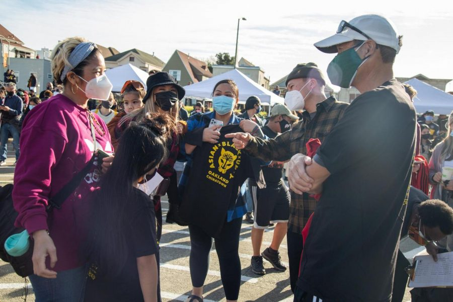 Attendees converse at a rally in Oakland on Feb. 13. The rally was held to promote healing and show support for victims of recent attacks against Asian-Americans.