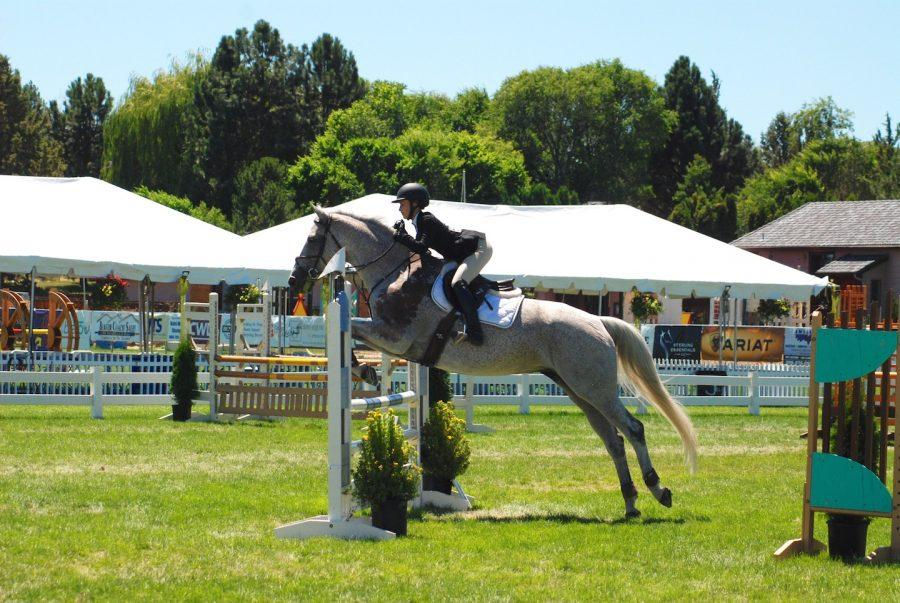 Kelsey and her horse participate in the Meters division for jumping at a tournament in Bend, Oregon. Kelsey won the championship for this division. (Courtesy of John Sarracino)