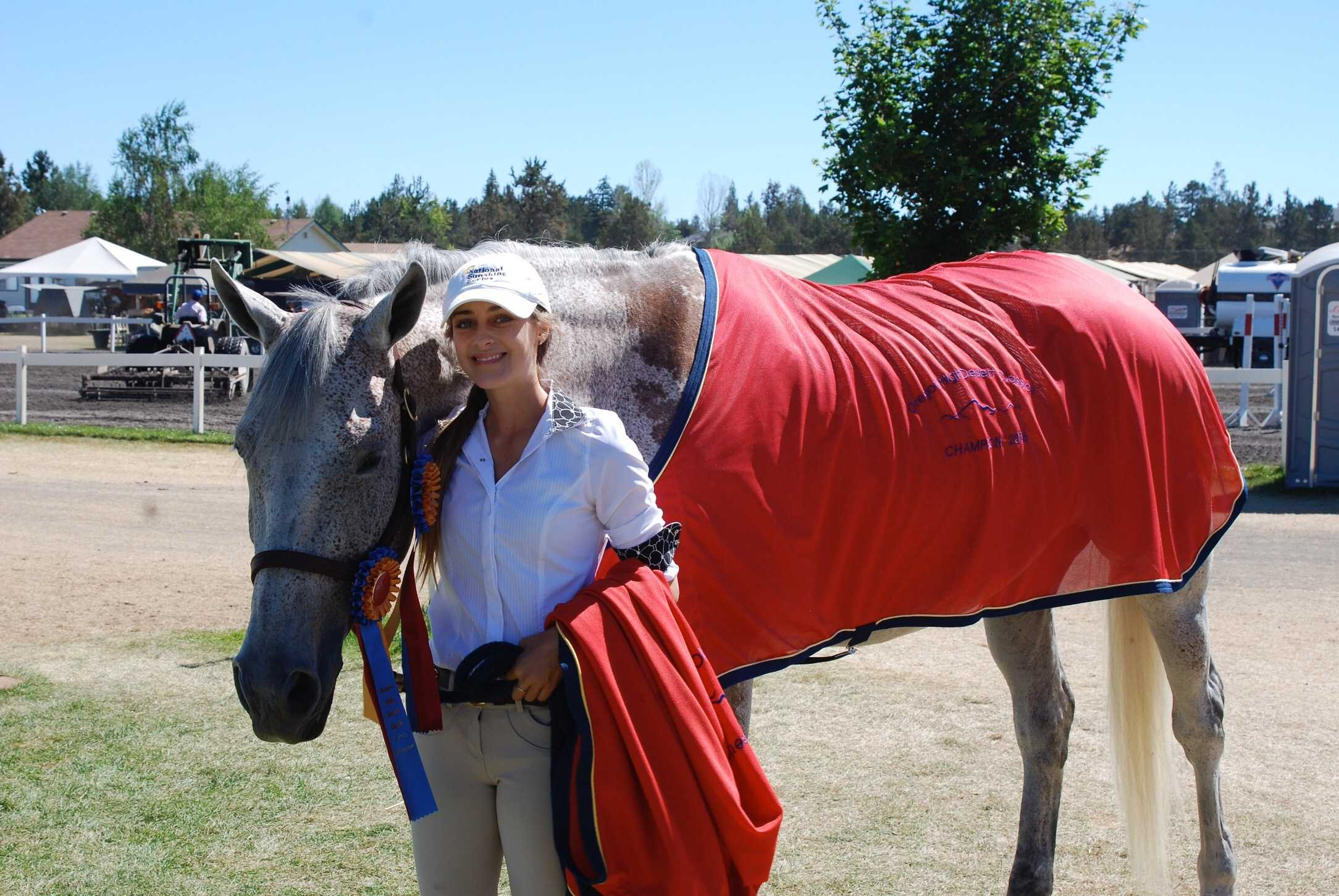 Kelsey Sarracino poses at a tournament with her horse, Kai.  She bought him this past spring in Canada. (Courtesy of John Sarracino)
