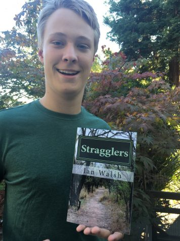 Ian Walsh, 15, with his book, Stragglers.