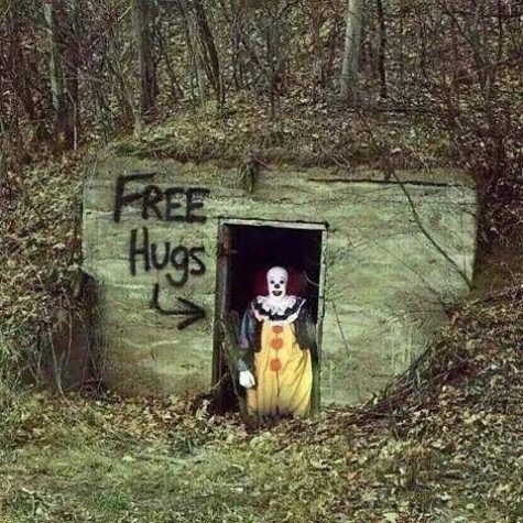 A mysterious picture of a creepy clown posing near an abandoned house. This picture was commonly reposted online during the clown hoax.  (Courtesy of google images/imgur)