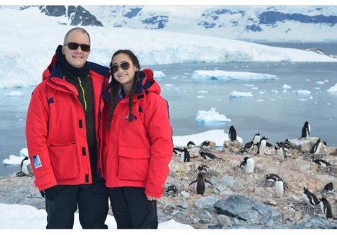 Bella Romano, with her dad, in Antarctica with the penguins. She visited the untouched continent over winter break, living off of cold chicken in a boat, surrounded by icebergs and snow-capped mountains. (Courtesy of Bella Romano)