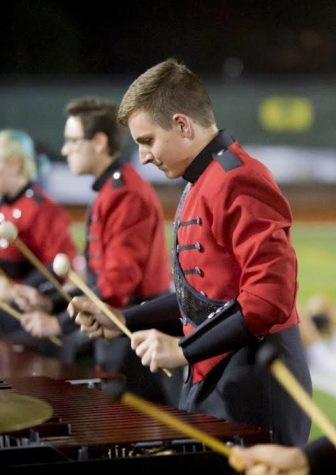 Junior Nick Bortolon plays the marimba during a field show for matching bad.  Bortolon has been playing since his sophomore year and the success has been plentiful (Courtesy of Nick Bortolon)