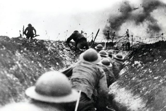 Soldiers climbing out of the trenches heading out to face the enemy. WWI was one of the bloodiest wars ever fought in human history.
