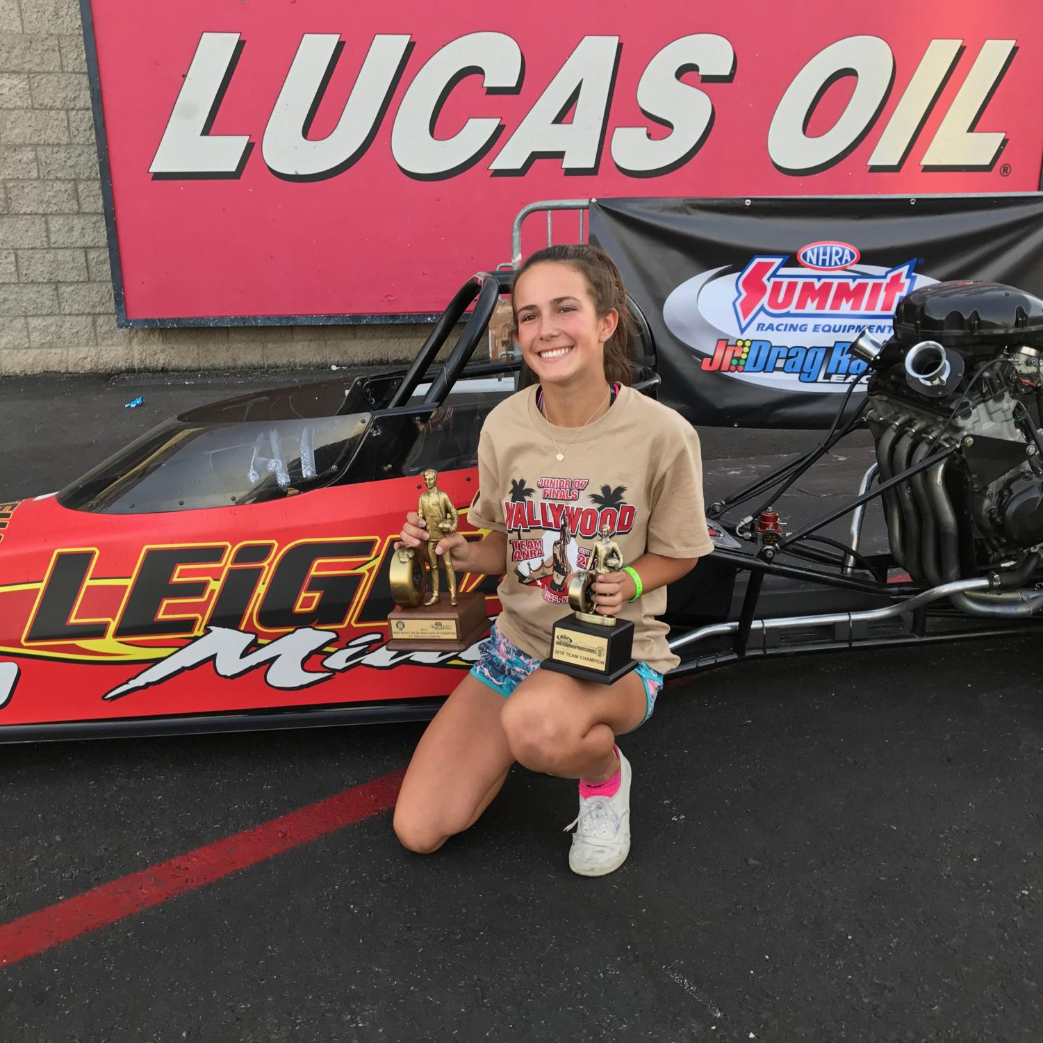 Sophomore Leigha Miller holds her trophies at the Jr. Drag Racing League. She has been drag racing since she was young as a way to bind with her dad.