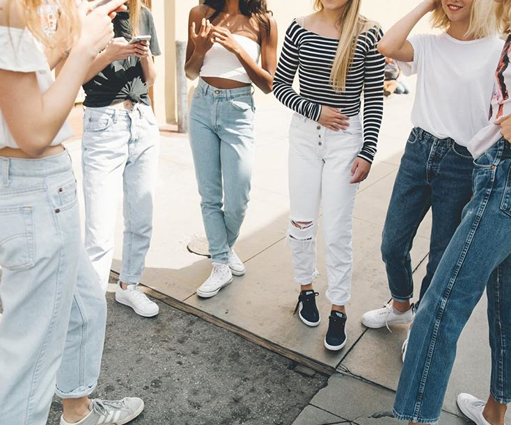 80%27s+trends+such+as+scrunchies%2C+mom+jeans+and+denim+jackets+are+extremely+popular+within+teen+girls.+This+photo+was+taken+for+Brandy+Melville%2C+a+popular+store+that+caters+to+many+teens+who+enjoy+wearing+those+trends.+