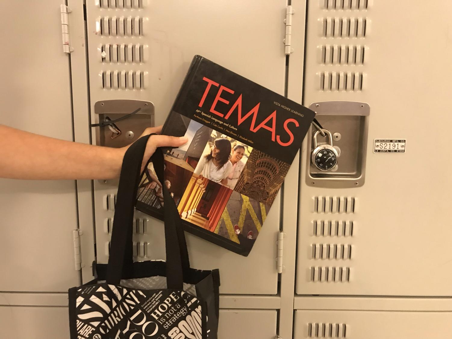 A zip tied locker is positioned beside a locker with a traditional lock, which is no longer accepted for non-freshmen without notice to the attendance office. Administration deemed that students stored too much trash in the lockers.
