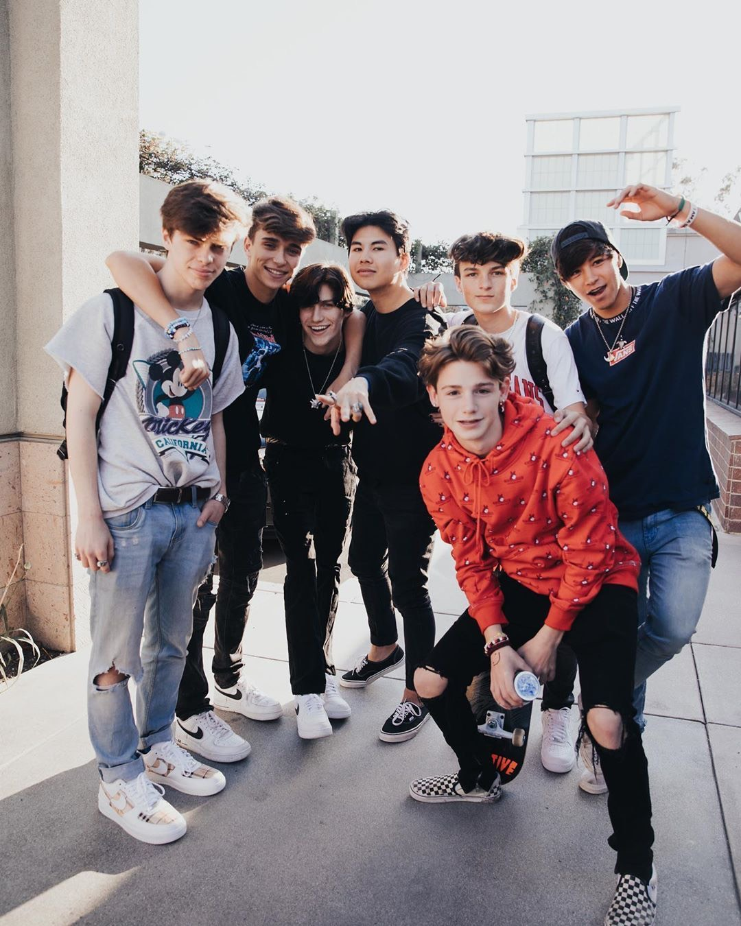 Seven boys of the 16 on the tour, pose for a photo before one of their meet ups.