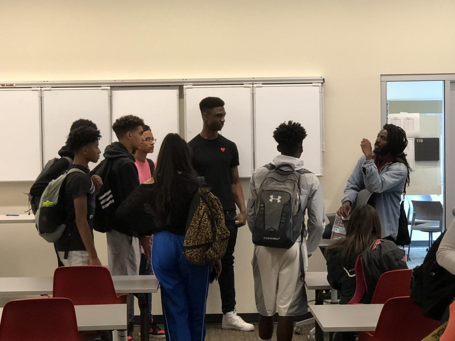 Poet Donte Clark speaks with Monte Vista students inside the Student Workday Center. He has been meeting with students every other Thursday where they have discussed about racial topics.
