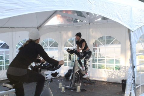 Jenn Soine, the owner of Star Cycle, instructs the riders of the 7:45 a.m. outdoor spin class. Although temperatures were borderline freezing, Soine continues the outdoor rides to ensure the comfort and safety of all participants. The bikes are six to eight feet apart and customers are required to use hand sanitizer before entering the makeshift studio.
