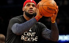 Lebron James warms up for a game wearing a T-shirt that says,