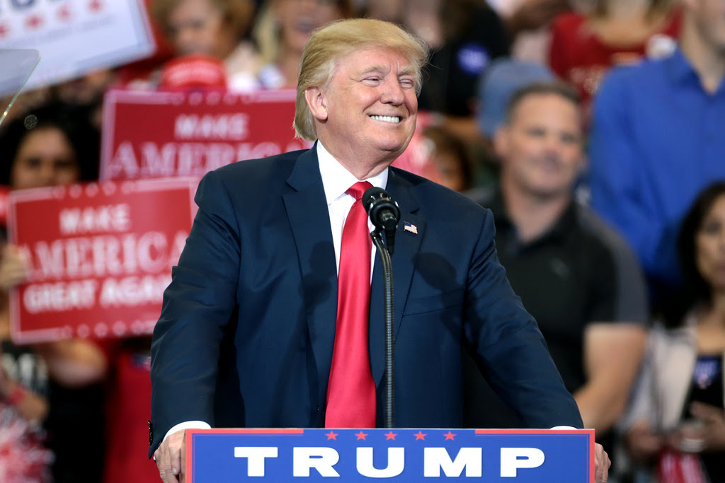 Donald Trump smiles like he is about to dupe millions of people into voting for him. The former host of The Apprentice took to Arizona to campaign in 2016.