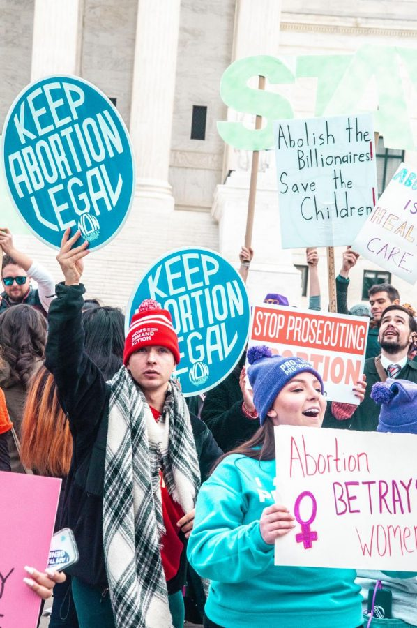 Pro-choice+and+pro-life+protesters+gather+in+front+of+The+Capitol.+Roe+V.+Wade+has+been+put+at+risk+due+to+the+replacement+of+Ruth+Bader+Ginsburg+with+Amy+Coney+Barrett.+