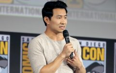 Simu Liu speaking at the 2019 San Diego Comic Con International. Simu Liu starred in Shang-Chi and the Legend of the Ten Rings as the first Asian lead in the Marvel Cinematic Universe