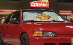 A candy-apple red 1995 Honda Civic hatchback EG flaunts its custom Lus Cookieez sunshade at a local gas station. This car belongs to non-other then Lus Cookieez owner Jacob Mangahas-Lu and was one of his main motives behind founding Lus.